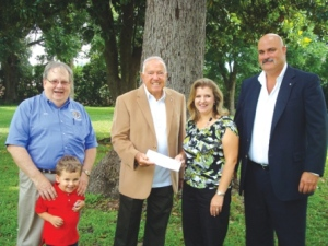 Danielle Howell, Caswell Center Foundation executive director, accepts a donation for the Caswell Developmental Center, from the Knights of Columbus. From left are John Gouldie, Knights of Columbus, with his grandson Dylan Dossary; Angelo Gibilaro, State Knight of Columbus treasurer; Howell; and Jim Laraia, Knights of Columbus.